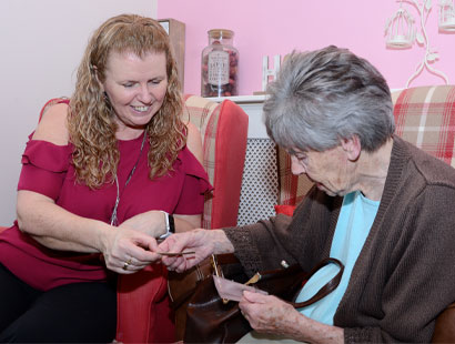 Carer and Resident playing Cards